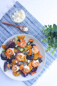 sweet potato beet shrimp salad feta blue napkin spoon