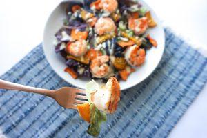 sweet potato beet shrimp salad feta blue napkin fork bite